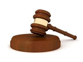 wooden brass judge gavel upright